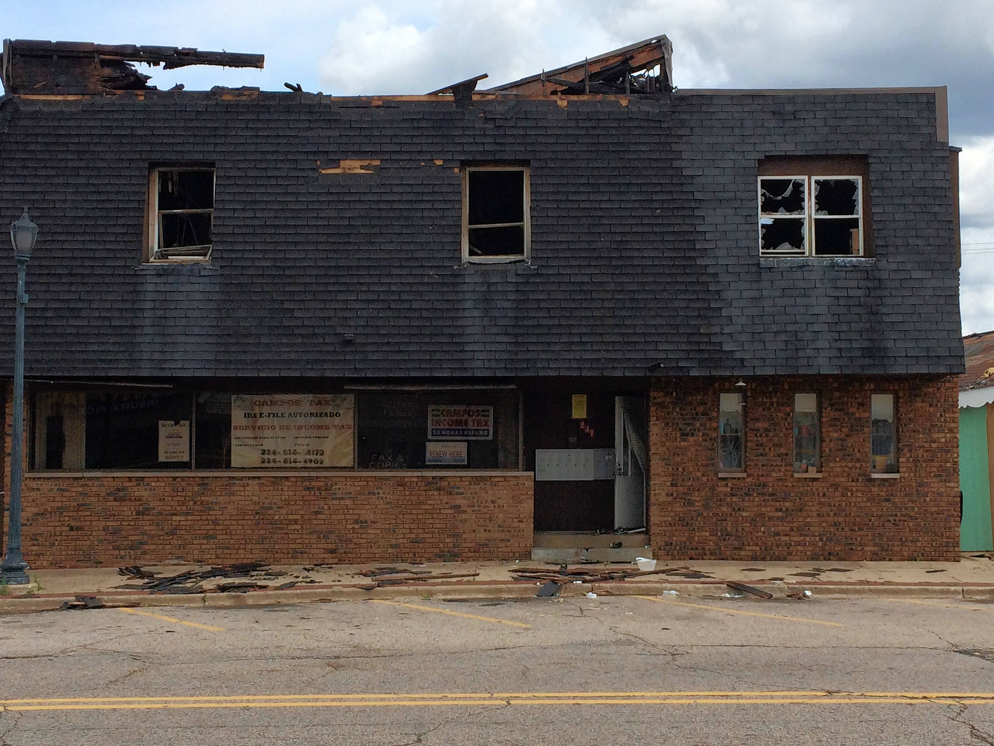 The roof collapsed in a Round Lake fire Friday evening where a person was later found dead in the rubble on the second floor. This is what the commercial building in the 200 block of North Cedar Lake Road looked like Saturday afternoon.