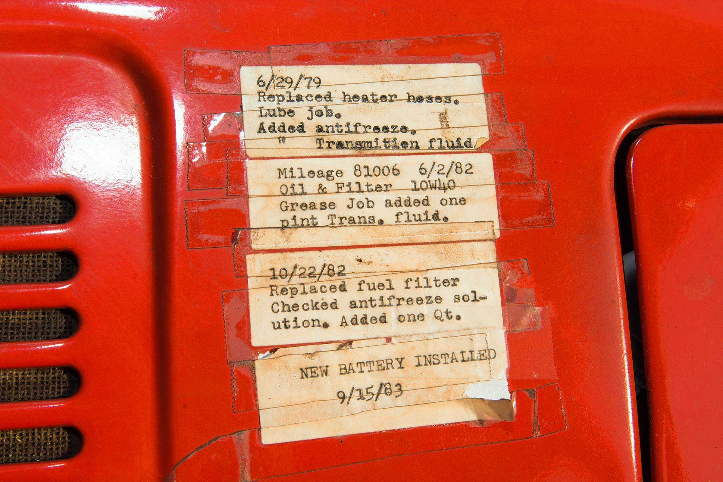 The original owner's maintenance records from the 1970s are still taped to the truck's dashboard.