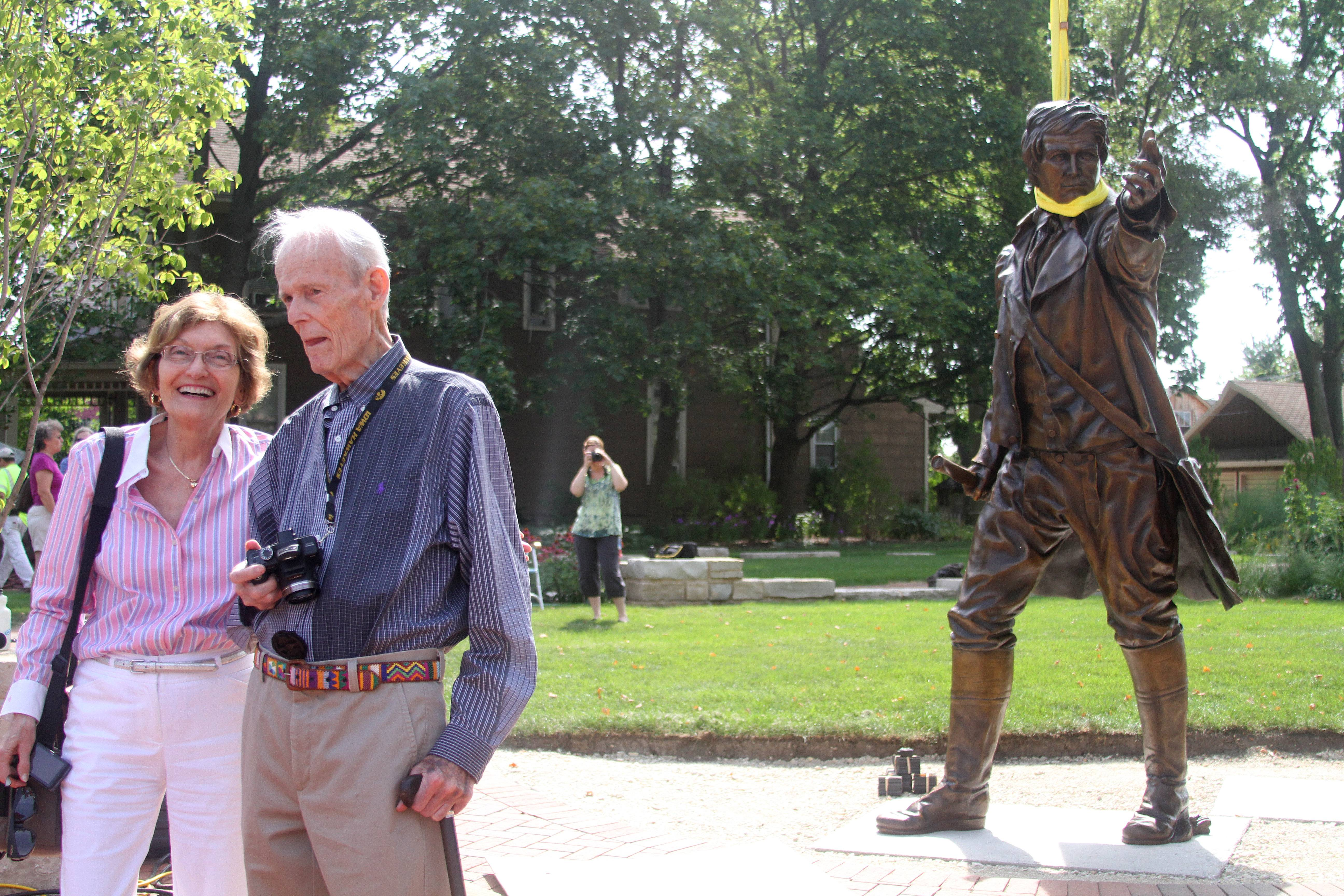 Mary and Dick Locher of Naperville were married 60 years before Dick's death Sunday at age 88. Here they attend the 2013 placement of a 9-foot-tall sculpture Dick Locher created of Naperville town founder Joseph Naper.