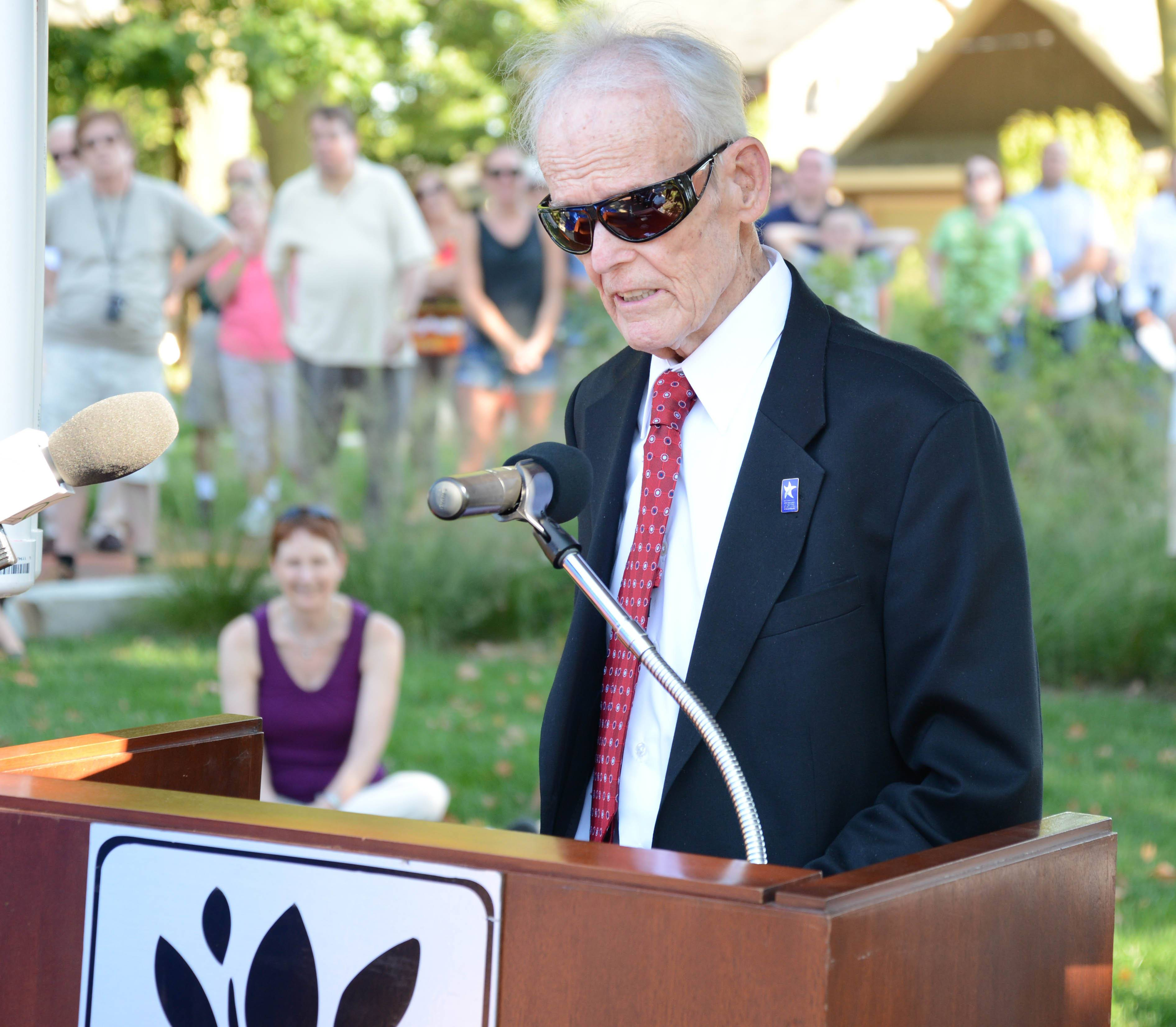 Naperville artist Dick Locher speaks in 2013 about the sculpture he created of town founder Joseph Naper. The piece was dedicated four years after Locher completed a sculpture of Dick Tracy, the comic strip detective he drew for years.