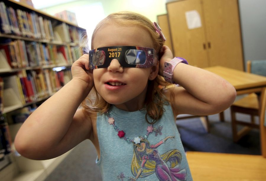 "Online scammers are selling fake ""eclipse glasses,"" which might not protect kids and adults from the dangers of looking at the sun on Aug. 21. Certified glasses from reputable dealers -- find them at eclipse.aas.org -- cost less than $2 a pair."