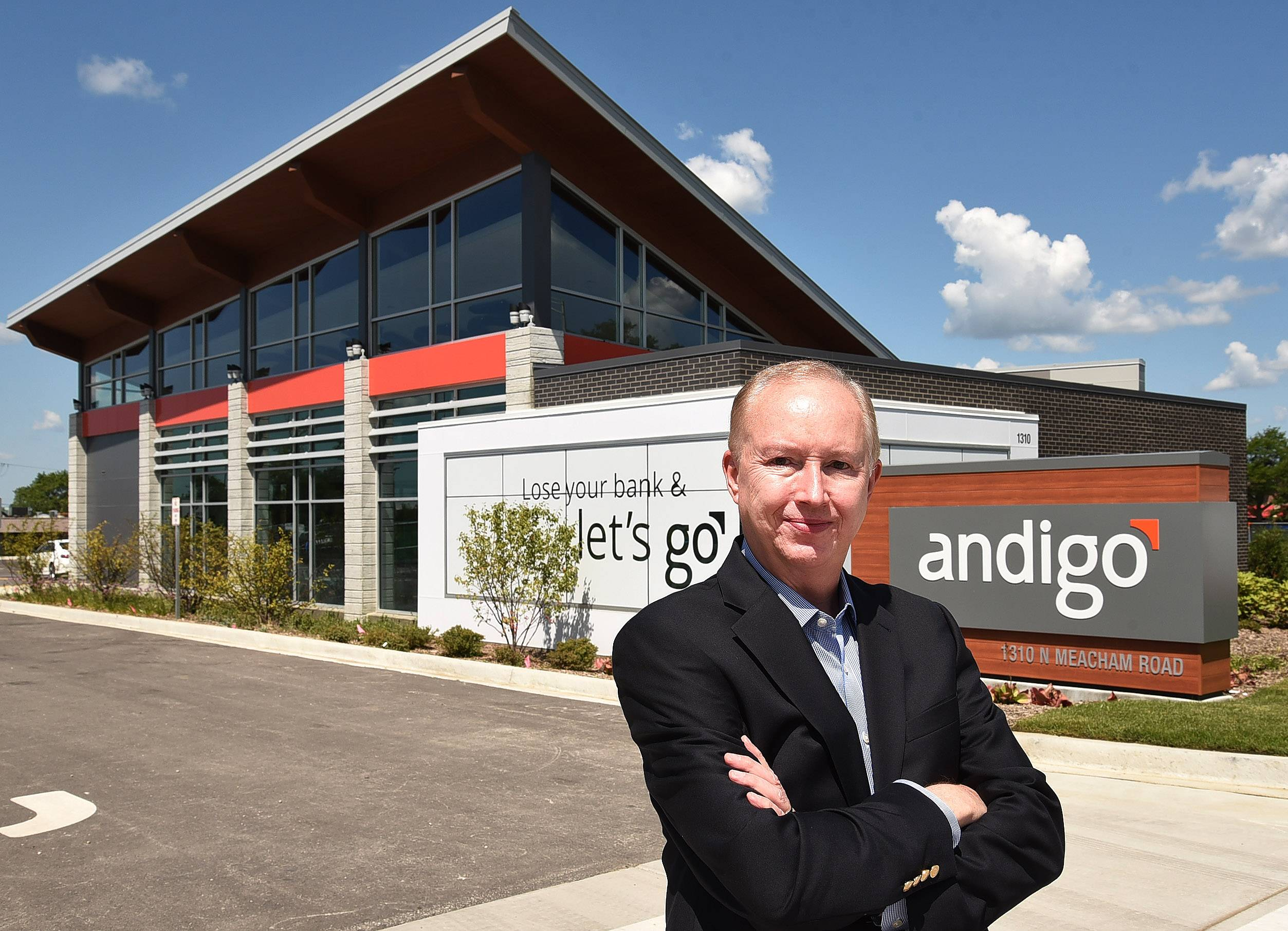 Andigo CEO Mike Murphy stands in front of the credit union's first retail branch in Schaumburg.