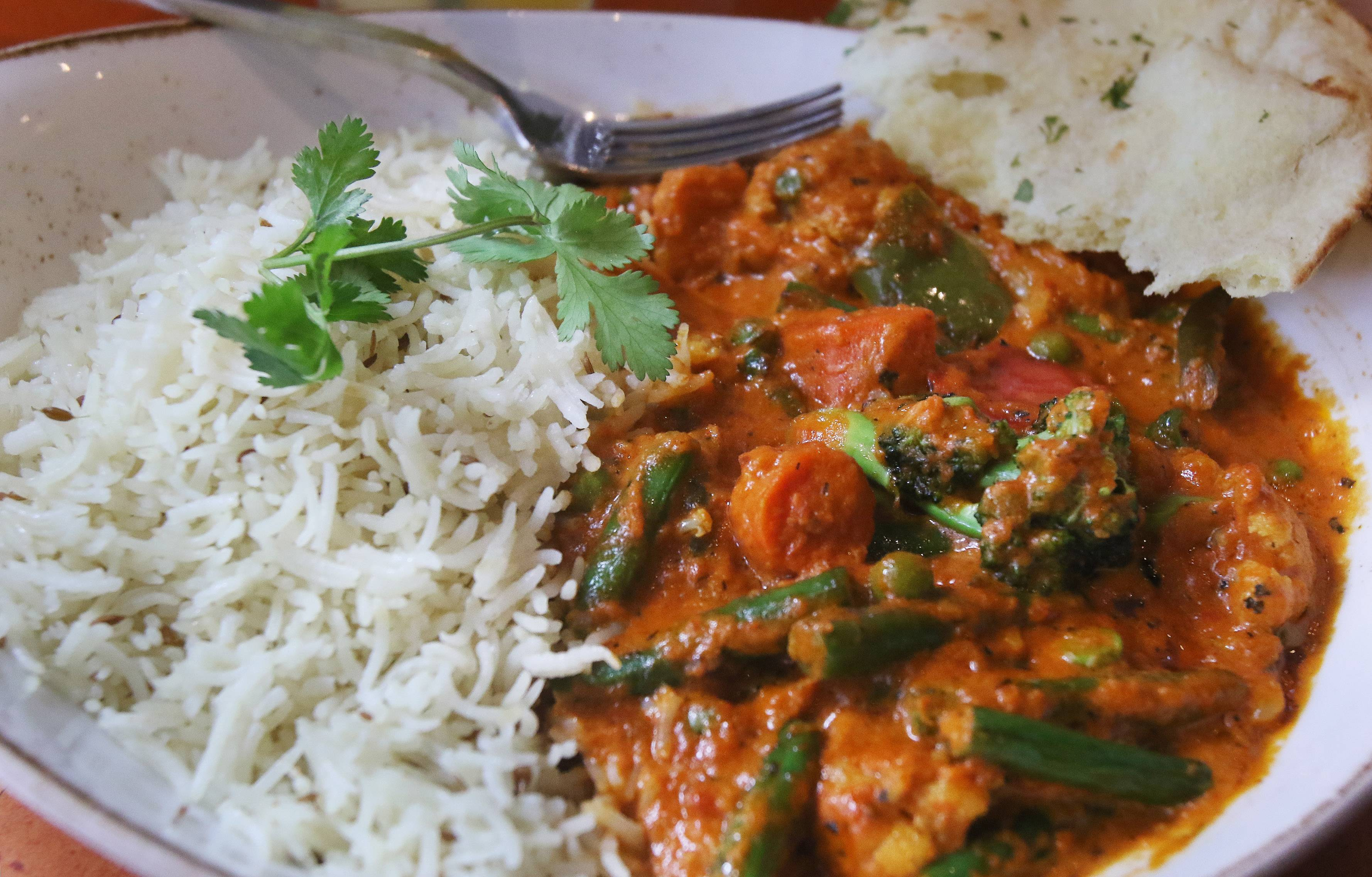 Marigold Maison's vegetable masala bowl features a tomato butter sauce and basmati rice.