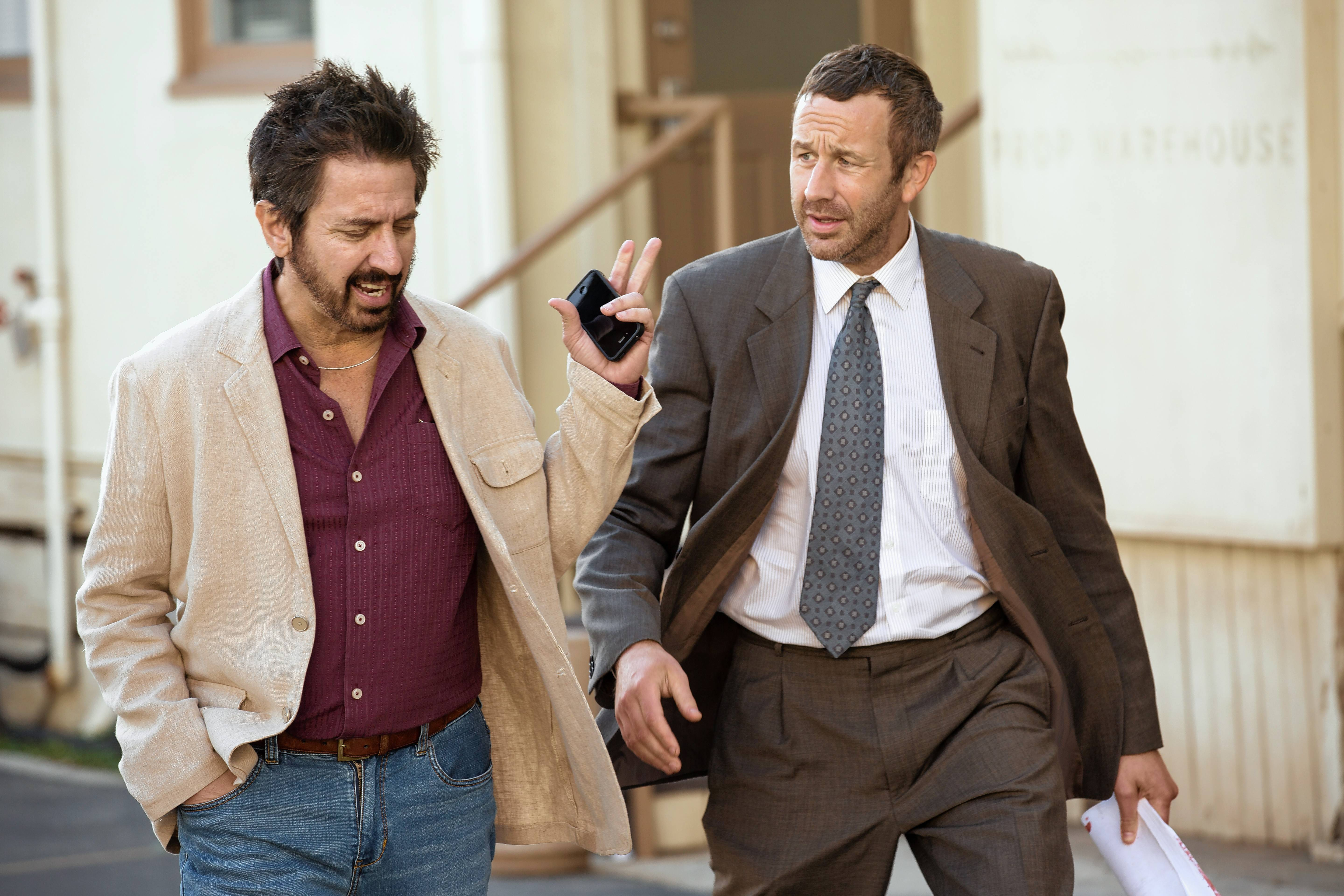 "A hitman (Chris O'Dowd), left, tries to start fresh in Hollywood with the help of a has-been filmmaker (Ray Romano) in the series version of ""Get Shorty,"" premiering on Sunday Aug. 13, on Epix."