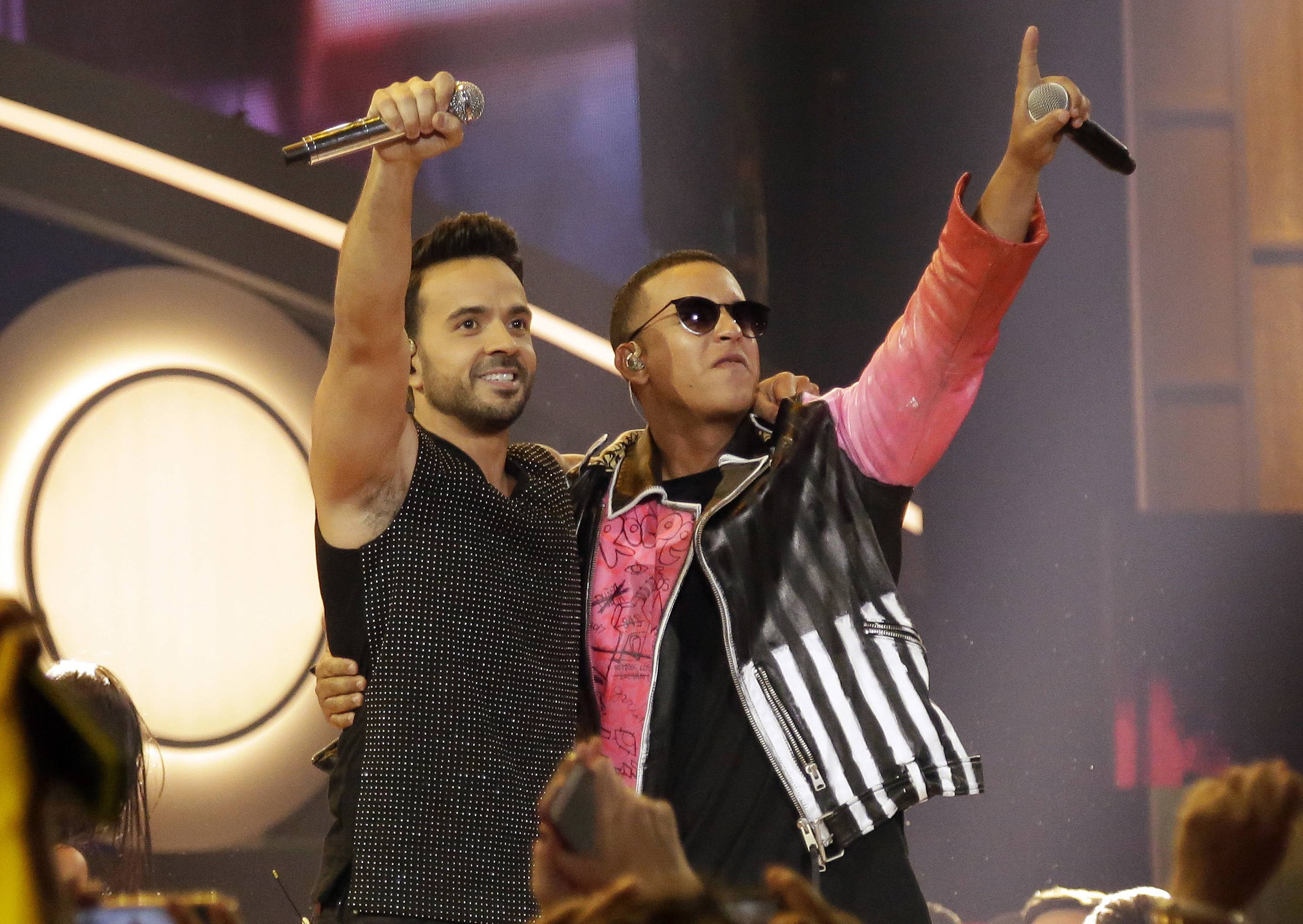 "Luis Fonsi, left, and Daddy Yankee perform earlier this year during the Latin Billboard Awards. The success of their hit song ""Despacito"" has stretched way beyond its Latin audience."