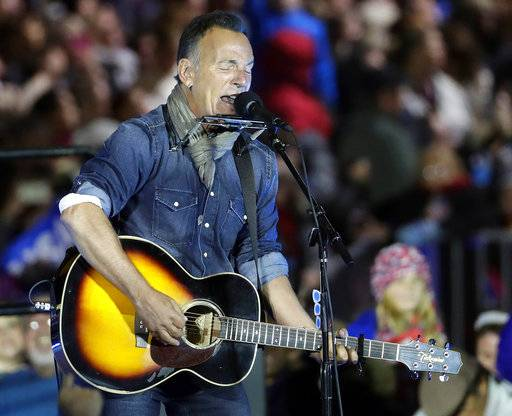 "FILE - In this Nov. 7, 2016, file photo Bruce Springsteen performs during a Hillary Clinton campaign event at Independence Mall in Philadelphia. Springsteen plans to make his Broadway debut onstage this fall at the Walter Kerr Theatre in a solo show in which he performs songs from his career, interspersed with readings of his best-selling memoir ""Born to Run.� ""Springsteen on Broadway� begins previews Oct. 3, 2017, ahead of an Oct. 12 opening. (AP Photo/Matt Slocum, File)"