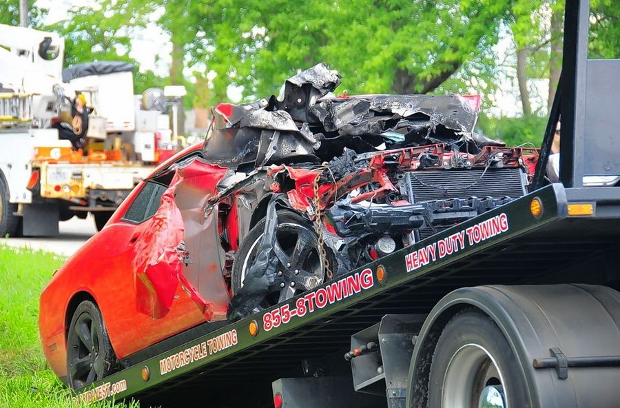 A 22-year-old Wauconda man is facing multiple charges after he crashed this red Dodge Challenger SRT Hellcat into a utility pole outside the Volo Auto Museum Wednesday morning while attempting to flee from a traffic stop, authorities said. He was not seriously injured.