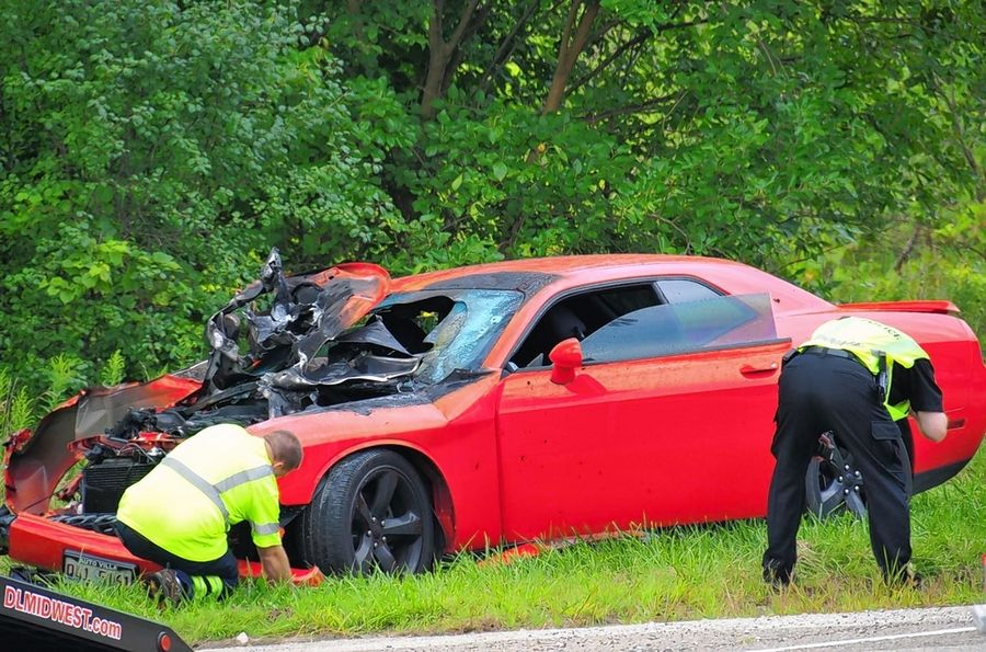 A 22-year-old Wauconda man is facing multiple charges after police say he crashed this red Dodge Challenger SRT Hellcat into a utility pole outside the Volo Auto Museum Wednesday morning while attempting to flee from a traffic stop. He was not seriously injured.