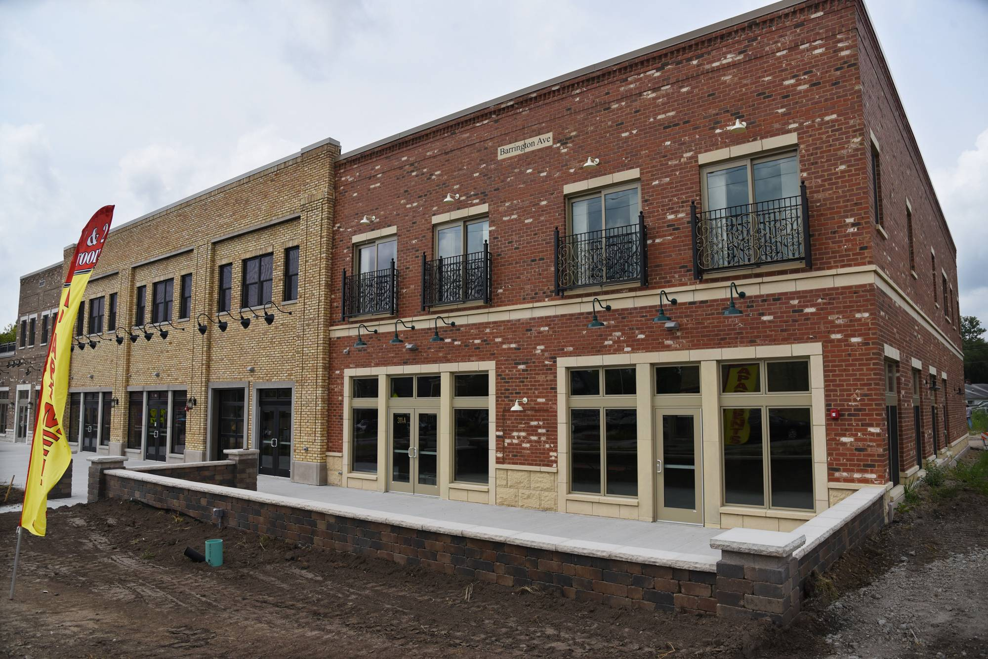 The new $4 million mixed-use development at 311 Barrington Ave., East Dundee, includes loft-style apartments upstairs and first-floor retail space.