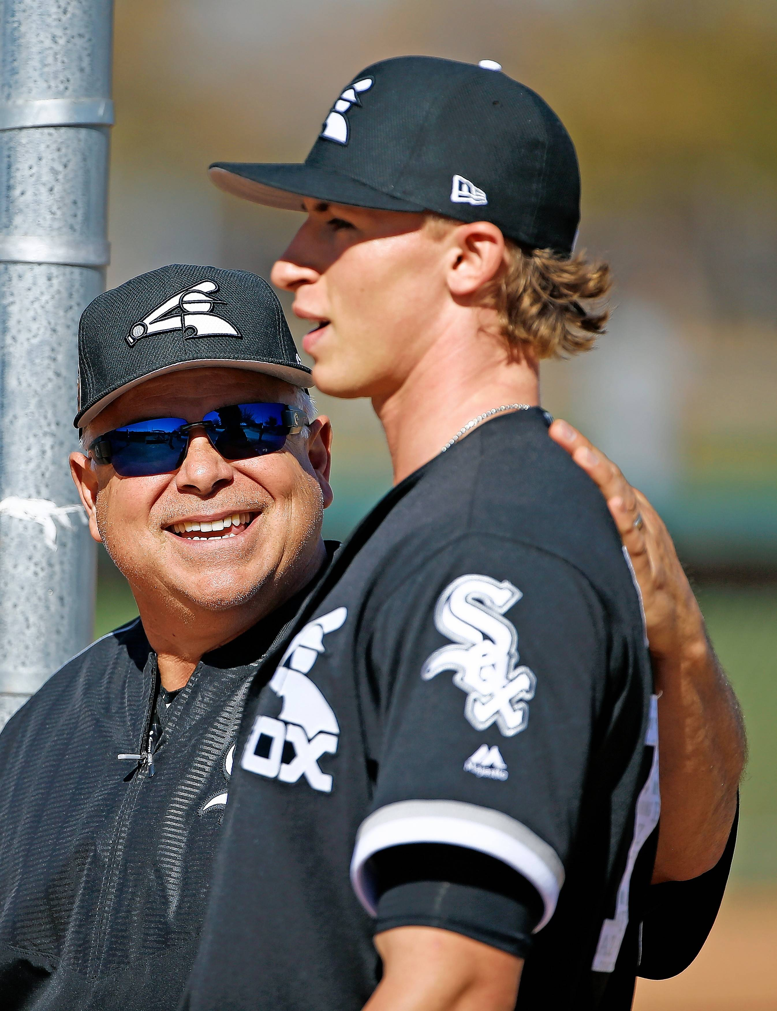 Chicago White Sox manager Rick Renteria, left, talks with pitcher Michael Kopech, right, after Kopech's throwing session at the White Sox baseball spring training facility Wednesday, Feb. 15, 2017, in Glendale, Ariz. (AP Photo/Ross D. Franklin)