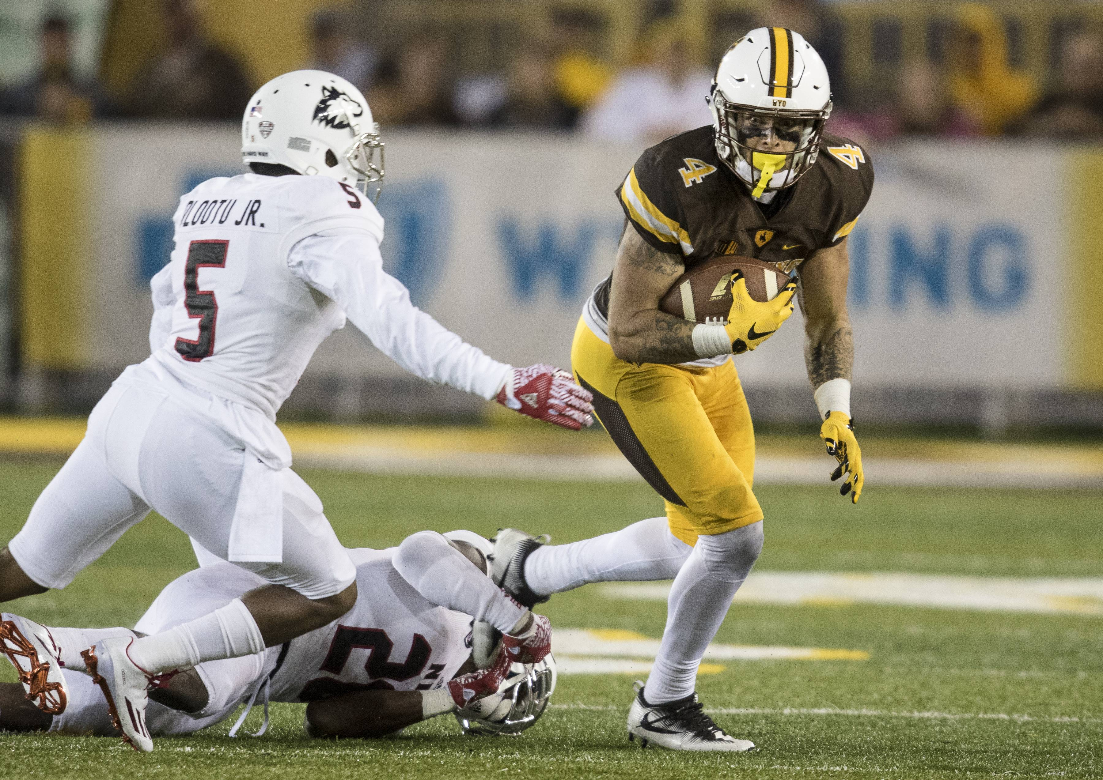 Wyoming wide receiver Tanner Gentry runs with the ball during an NCAA college football game against Northern Illinois Saturday, Sept. 4, 2016 at the War Memorial Stadium in Laramie, Wyo. (Hugh Carey/The Wyoming Tribune Eagle via AP)