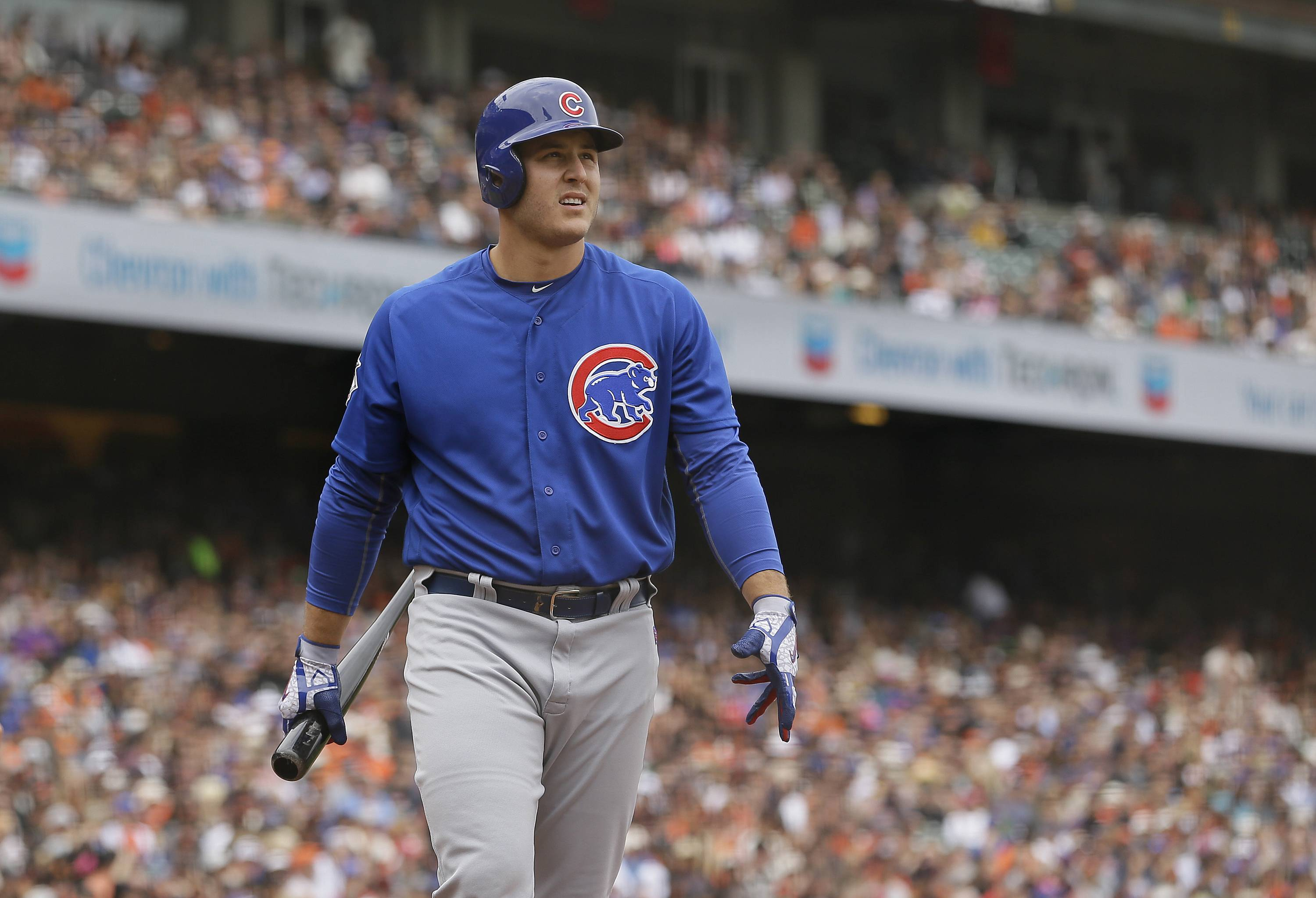 Chicago Cubs pinch hitter Anthony Rizzo walks back to the dugout after striking out swinging against San Francisco Giants relief pitcher Hunter Strickland in the eighth inning of a baseball game Wednesday, Aug. 9, 2017, in San Francisco. San Francisco won the game 3-1. (AP Photo/Eric Risberg)