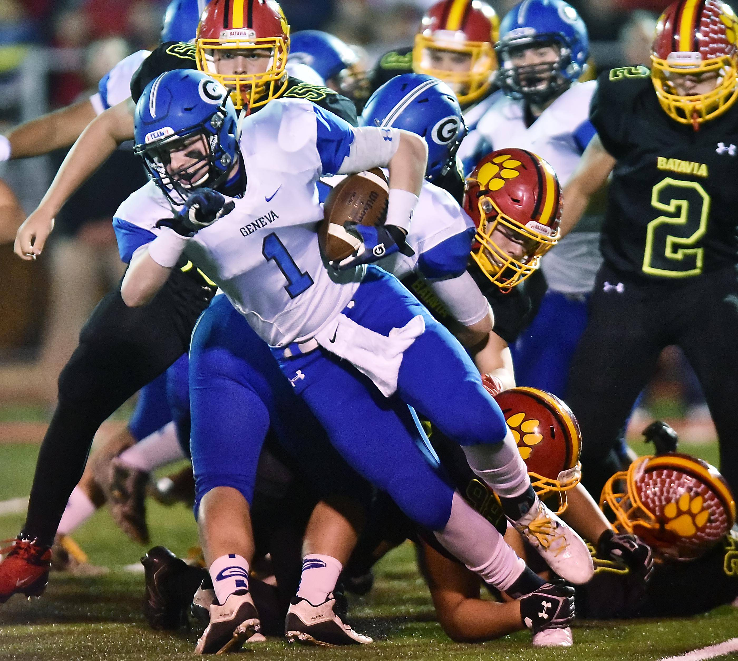 The National Federation of State High Schools wants to protect the tradition of Friday night football, like this game between Geneva and Batavia, from being run over by an increase in college games on Friday nights.