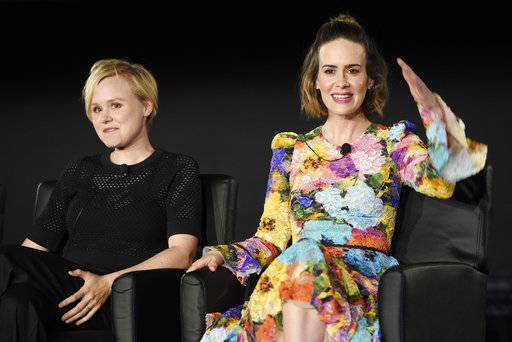 "Alison Pill, left, and Sarah Paulson, cast members in the FX series ""American Horror Story,"" take part in a panel discussion on the show during the 2017 Television Critics Association Summer Press Tour at 20th Century Fox Studios on Wednesday, Aug. 9, 2017, in Los Angeles. (Photo by Chris Pizzello/Invision/AP)"