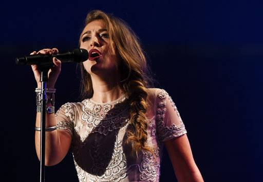 FILE - In this Tuesday, Oct. 13, 2015, file photo, Lauren Daigle performs during the Dove Awards in Nashville. Producer-songwriter Wayne Haun, Daigle and rock singer Zach Williams are the top nominees at the 2017 GMA Dove Awards, honoring gospel and Christian music, announced Wednesday, Aug. 9, 2017. (AP Photo/Mark Zaleski, File)