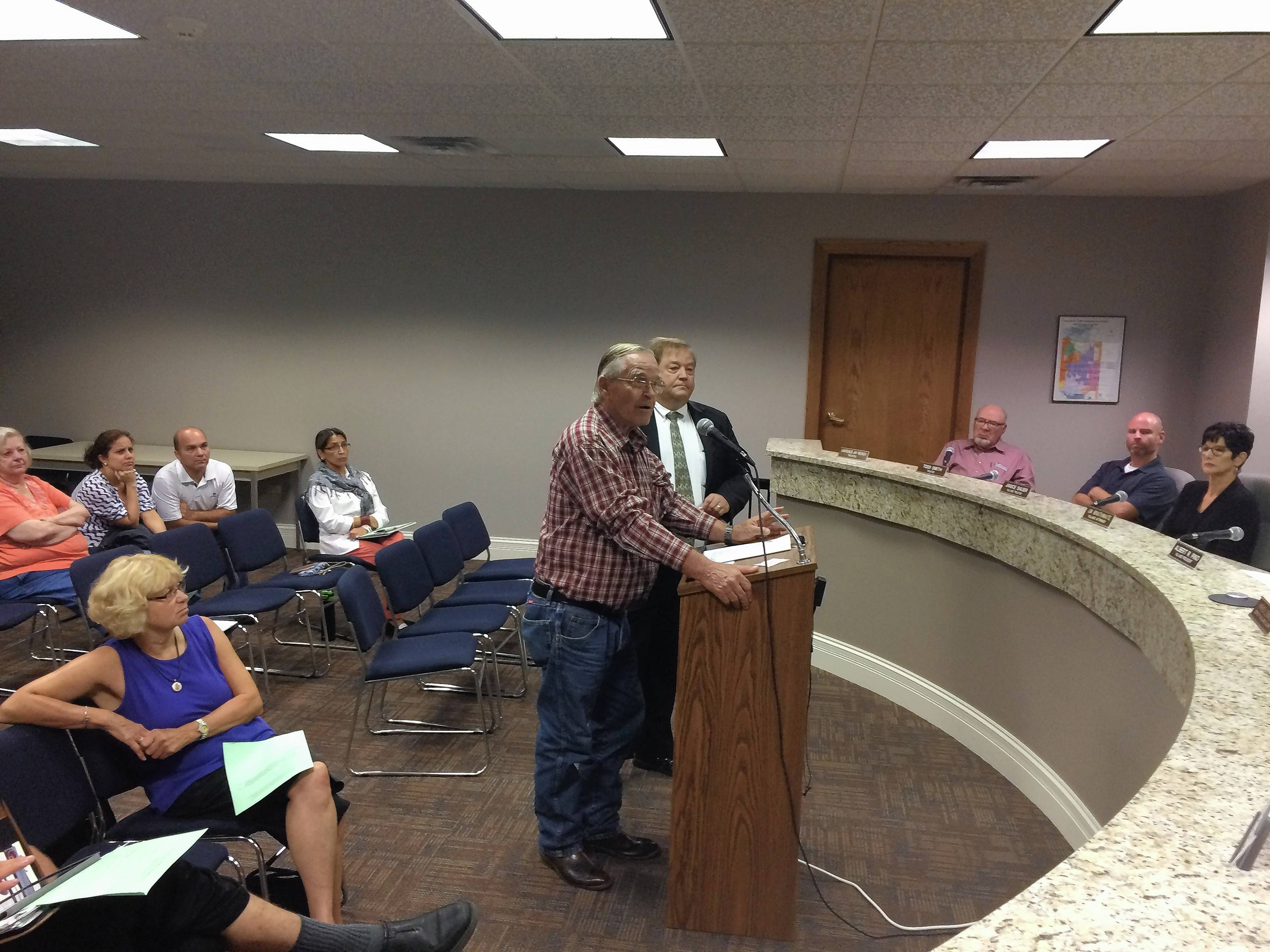 Kevin Johnson, foreground, who lives in unincorporated Lake County near North Barrington's border, opposes a plan for a large-scale poultry farm near his home. He was accomplained by his son, K.O., when he voiced concern to the North Barrington village board.
