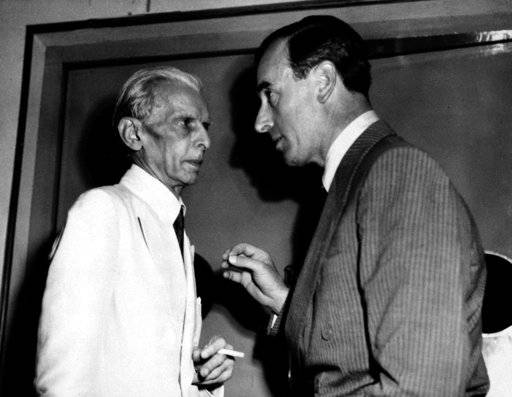 FILE- In this June 10, 1947 file photo, Viceroy of India Lord Louis Mountbatten, right, speaks with Muslim League leader Muhammed Ali Jinnah during conferences on India's division in New Delhi. Jinnah appealed to Indians to carry out peacefully the British plan for dividing the country. The Muslim League formally adopted the plan on the night of June 9. As the 70th anniversary of India-Pakistan Partition comes up next week, relations between the two nations are as broken as ever. In some ways, their violent birth pangs dictated their future course through suspicion and animosity. (AP Photo/Max Desfor, File)