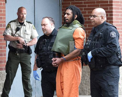 FILE - In this May 10, 2017, file photo, Wesley Correa-Carmenaty is led into the Woodbury County Jail in Sioux City, Iowa. Prosecutors say the man charged with killing a sheriff's deputy and wounding another while escaping from an Iowa jail will plead guilty. (Tim Hynds/Sioux City Journal via AP, File)
