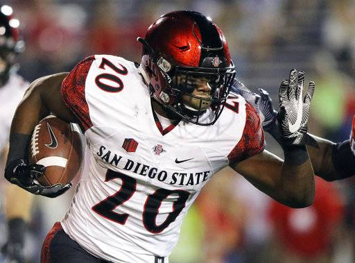 FILE - In this Oct. 1, 2016, file photo, San Diego State Aztecs running back Rashaad Penny runs the ball against the South Alabama Jaguars during the first half of an NCAA college football game in Mobile, Ala. (AP Photo/Dan Anderson, File)