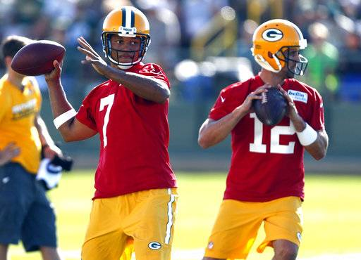 FILE - In this July 26, 2016, file photo, Green Bay Packers quarterback Brett Hundley (7) and quarterback Aaron Rodgers (12) throw during NFL football training camp in Green Bay, Wis. Hundley is eager to get some meaningful snaps when the Packers host the Philadelphia Eagles to open their preseason schedule on Thursday. Rodgers appears likely to sit this game out, though Rodgers says he won't be hovering over his backup either. (AP Photo/Matt Ludtke, File)