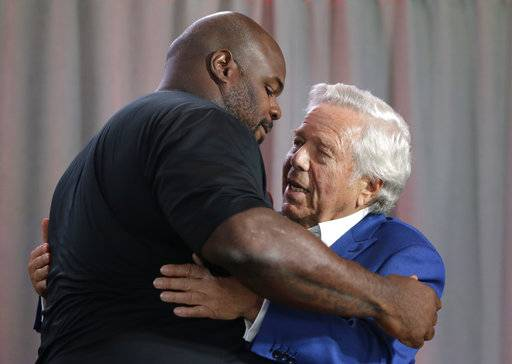 Former New England Patriots' Vince Wilfork, left, hugs Patriots owner Robert Kraft, during a news conference at Gillette Stadium, Wednesday, Aug. 9, 2017, in Foxborough, Mass., where Wilfork announce his retirement from NFL football. Wilfork signed a contract during the news conference to make him a Patriots life member. (AP Photo/Steven Senne)