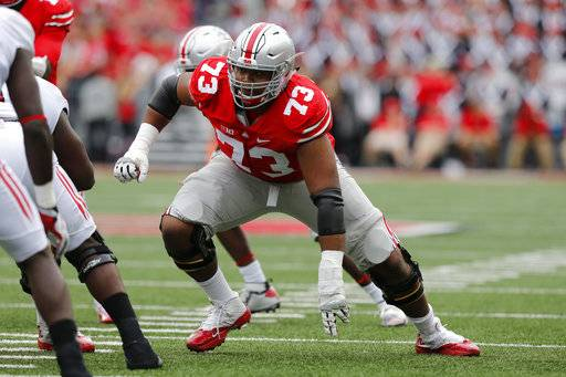 FILE - In this Oct. 1, 2016, file photo, Ohio State offensive lineman Michael Jordan plays against Rutgers during an NCAA college football game in Columbus, Ohio. Ohio State's offensive linemen are eager to prove they are not the team's weakest link. (AP Photo/Jay LaPrete, File)