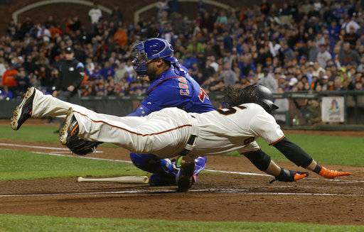 San Francisco Giants' Brandon Crawford, bottom, scores past Chicago Cubs catcher Willson Contreras during the fourth inning of a baseball game in San Francisco, Tuesday, Aug. 8, 2017. (AP Photo/Jeff Chiu)