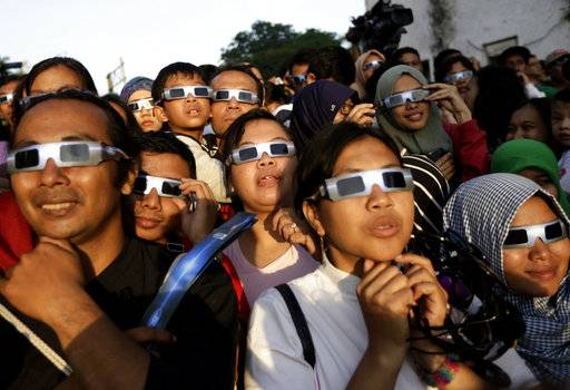 Science Says: Solar specs needed for safe viewing of eclipse