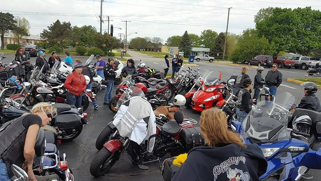 A group gathers at Woodstock Harley-Davidson earlier this year for a bike blessing and ride.