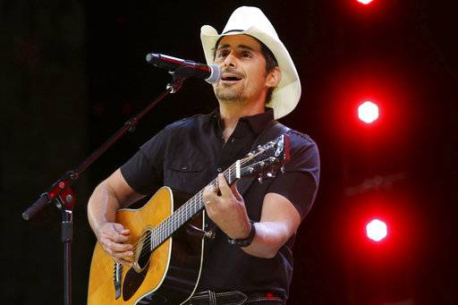 "Country music recording artist Brad Paisley performs at the graduation for Barrington High School at Willow Creek Community Church in South Barrington. Paisley says years of hosting the Country Music Awards and writing songs with humorous lyrics have - hopefully - prepared him to host his first comedy special, the ""Brad Paisley Comedy Rodeo,� which will premiere on Netflix on Tuesday, Aug. 15. (Steve Lundy /Daily Herald via AP, File)"