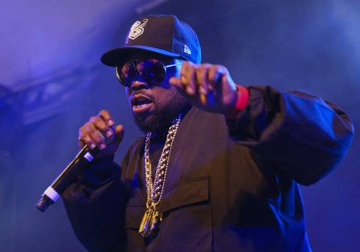 FILE - In this March 15, 2016, file photo, Big Boi performs at the South by Southwest Interactive Festival closing party at Stubb's in Austin, Texas. Big Boi presented a puppy on August 10, 2017, to a little girl who was paralyzed in an April shooting. (Photo by Jack Plunkett/Invision/AP, File)