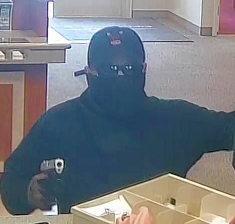 With a mask, cap, sunglasses and even gloves, this robber did his best to conceal his identity while holding up a North suburban bank last month. But poor choice of a getaway car may have doomed him.