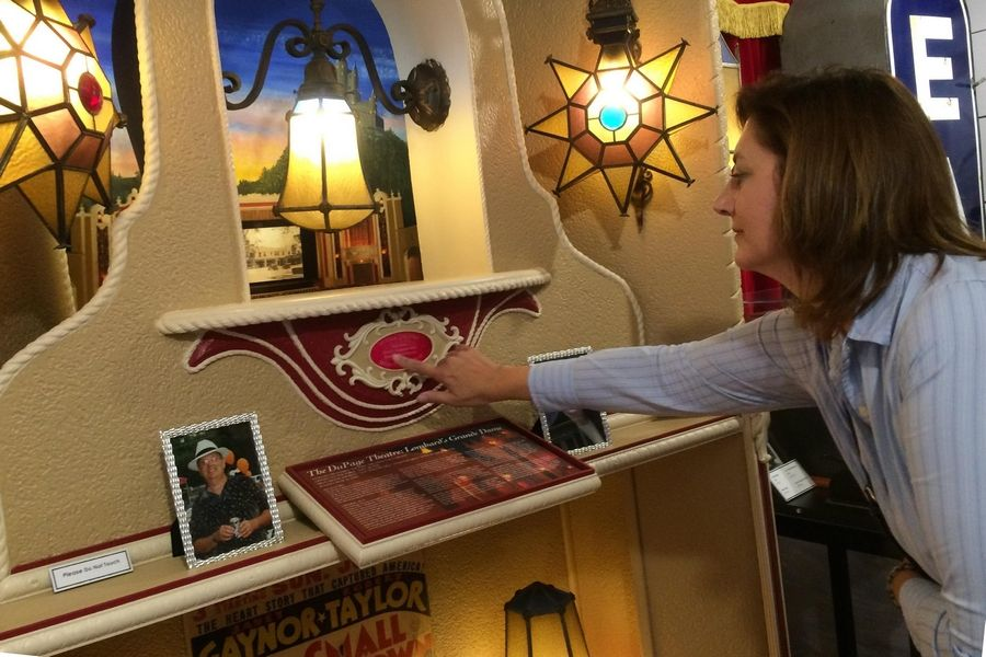 A new memorial to the DuPage Theatre features original lamps from the Lombard icon that was torn down in 2007. Deb Dynako, president of Friends of the DuPage Theatre, took a closer look at the display unveiled Thursday at the Lombard Historical Society's Carriage House.
