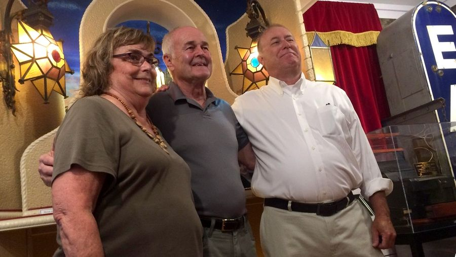 Bettie Christensen and Tyler Williams, right, joined Pete Kramer, center, who dedicated a tribute to the DuPage Theatre Thursday to their late spouses.