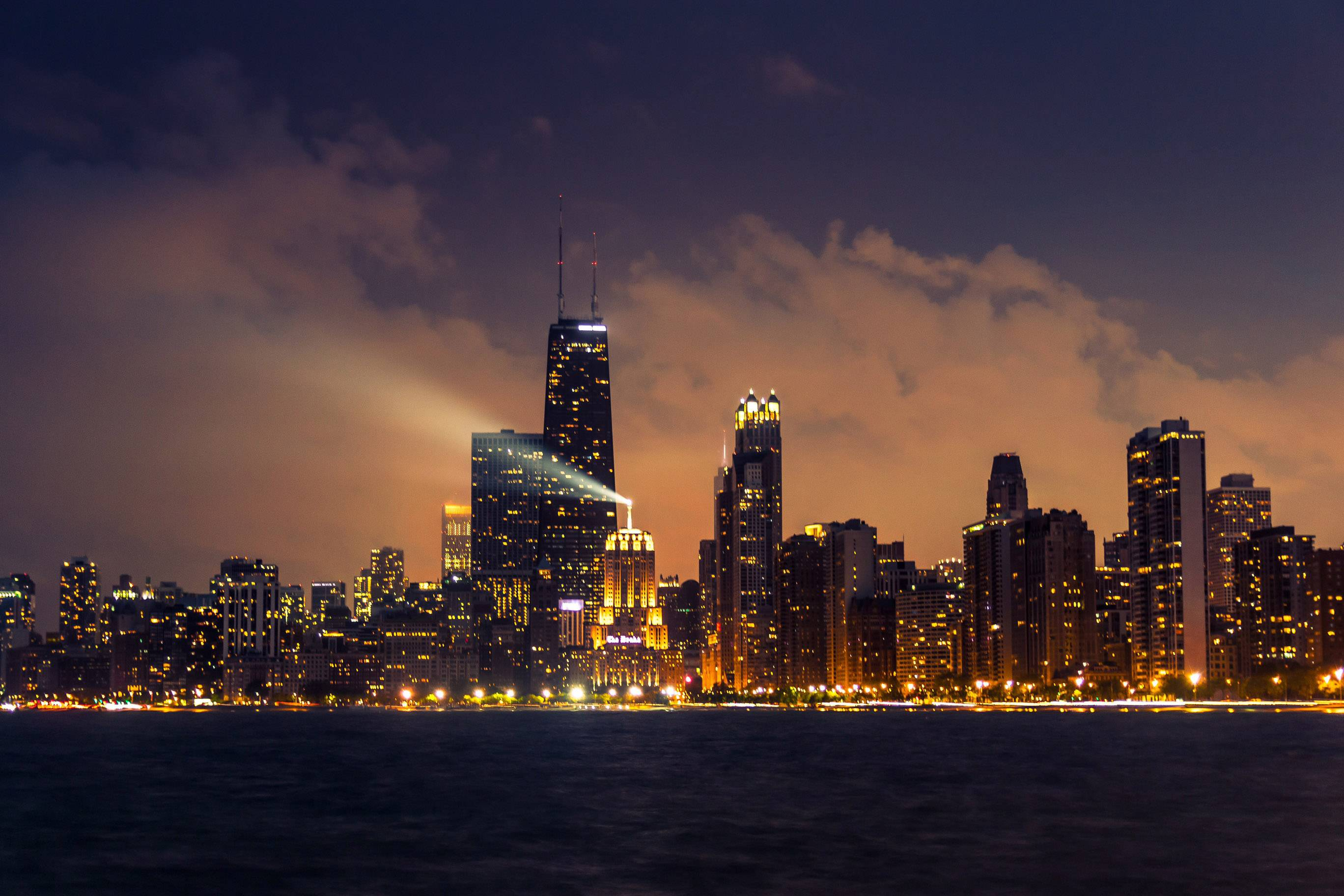 On a misty night in Chicago, the beacon light warns ships on Lake Michigan traveling in the dark night that land is nearby.