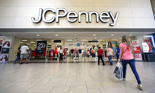 FILE - In this Wednesday, June 7, 2017, file photo, shoppers walk into a J.C. Penney department store in Hialeah, Fla. On Friday, Aug. 11, 2017,  J.C. Penney Company, Inc. Holding Company reports earnings.