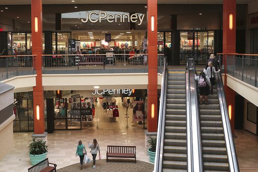 In this Friday, March 17, 2017, photo, shoppers head to a J.C. Penney store in the Georgia Square Mall in Athens, Ga. On Friday, Aug. 11, 2017,  J.C. Penney Company, Inc. Holding Company reports earnings. (John Roark/Athens Banner-Herald via AP, File)
