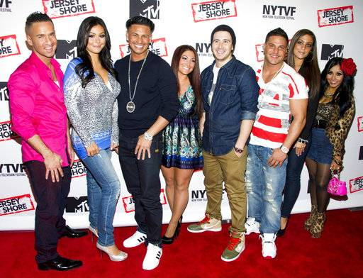 "FILE - This Oct. 24, 2012 file photo shows ""Jersey Shore"" cast members, from left, Mike ""The Situation"" Sorrentino, Jenni ""JWoww"" Farley, Paul ""Pauly D"" Delvecchio, Deena Cortese, Vinny Guadagnino, Ronnie Ortiz-Magro, Sammi ""Sweetheart"" Giancola and Nicole ""Snooki"" Polizzi at a panel entitled ""Love, Loss, (Gym, Tan) and Laundry: A Farewell to the Jersey Shore"" in New York. The cast of ""Jersey Shore� is doing it all again for a special on the E! Network. ""Reunion Road Trip: Return to the Jersey Shore� brings the gang back together for the first time in five years. It airs Aug. 20, 2017. (Photo by Charles Sykes/Invision/AP, File)"