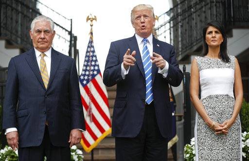 President Donald Trump gestures while speaking following his meeting with Secretary of State Rex Tillerson, left, and U.S. Ambassador to the United Nations Nikki Haley at Trump National Golf Club in Bedminster, N.J., Friday, Aug. 11, 2017. (AP Photo/Pablo Martinez Monsivais)