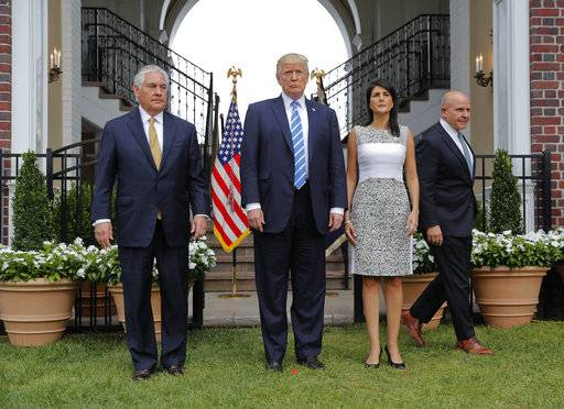 President Donald Trump with from left, Secretary of State Rex Tillerson, U.S. Ambassador to the United Nations Nikki Haley and national security adviser H.R. McMaster, arrive to speak to members of the media following their meeting at Trump National Golf Club in Bedminster, N.J., Friday, Aug. 11, 2017. (AP Photo/Pablo Martinez Monsivais)