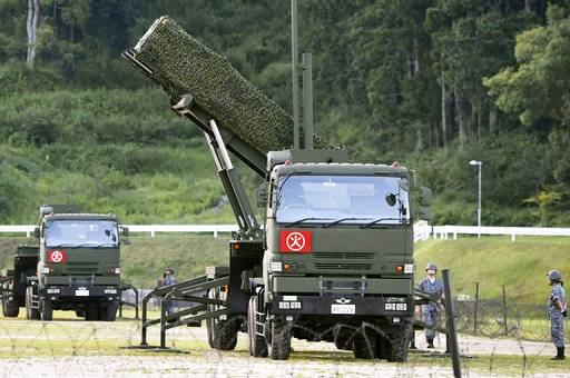 A PAC-3 interceptor is deployed in the compound of a garrison of the Japan Ground Self-Defense Force in Konan, Kochi prefecture, Japan, Saturday, Aug. 12, 2017. Japan started deploying land-based Patriot interceptors after North Korea threatened to send ballistic missiles flying over western Japan and landing near Guam. The Defense Ministry said Friday the PAC-3 surface-to-air interceptors are being deployed at four locations - Hiroshima, Kochi, Shimane and Ehime. (Ryosuke Ozawa/Kyodo News via AP)