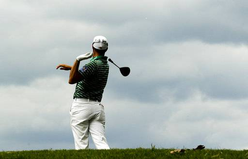 Adam Hadwin reacts to his tee shot on the 15th hole during the second round of the PGA Championship golf tournament at the Quail Hollow Club Friday, Aug. 11, 2017, in Charlotte, N.C. (AP Photo/Chris O'Meara)