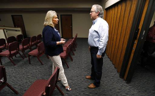 "In this Wednesday, Aug. 2, 2017 photo, U.S. Rep. David Young, R-Iowa, speaks with Glenwood Area Chamber of Commerce Executive Director Linda Washburn, left, during a stop at the Glenwood City Hall, in Glenwood, Iowa. Conservatives in Young's district are angry with the GOP's failure to repeal and replace Obamacare. Independents don't like the partisan approach. And now Democrats are making an issue of Young's vote for a health care bill that President Donald Trump called ""mean."" (AP Photo/Charlie Neibergall)"