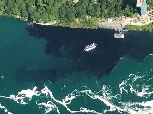FILE - In this July 29, 2017 file photo provided by Rainbow Air INC., black-colored wastewater treatment discharge is released into water below Niagara Falls, in Niagara Falls, N.Y. Local lawmakers are asking for a criminal investigation into the discharge of wastewater that turned the water below Niagara Falls black. The Niagara County Legislature passed resolutions Thursday, Aug. 10, 2017 that request investigations by the New York state attorney general, the Niagara County district attorney and the federal Environmental Protection Agency. (Patrick J. Proctor/Rainbow Air INC. via AP)