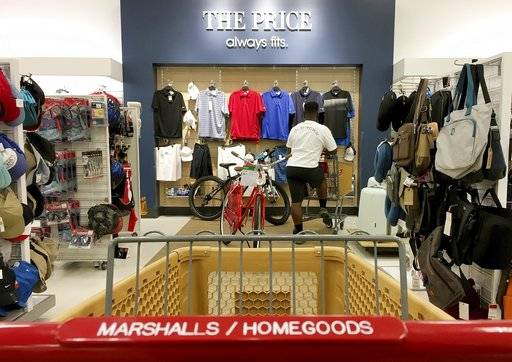 In this Monday, May 15, 2017, photo, a shopper looks at shirts at a Marshalls & Home Goods retail store, part of the TJX Companies brand, in Phoenix. On Friday, Aug. 11, 2017, the Labor Department reports on U.S. consumer prices for July. (AP Photo/Ross D. Franklin)