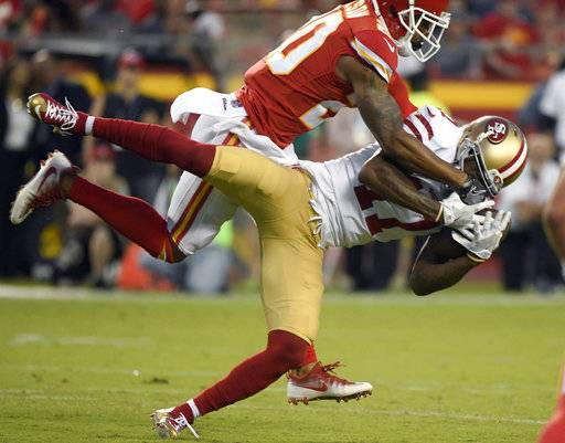 San Francisco 49ers wide receiver Jeremy Kerley (17) makes a catch against Kansas City Chiefs defensive back Steven Nelson (20) during the first half of an NFL preseason football game in Kansas City, Mo., Friday, Aug. 11, 2017. (AP Photo/Ed Zurga)