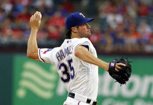 Texas Rangers starting pitcher Cole Hamels throws to the Houston Astros during the third inning of a baseball game, Friday, Aug. 11, 2017, in Arlington, Texas. (AP Photo/Tony Gutierrez)