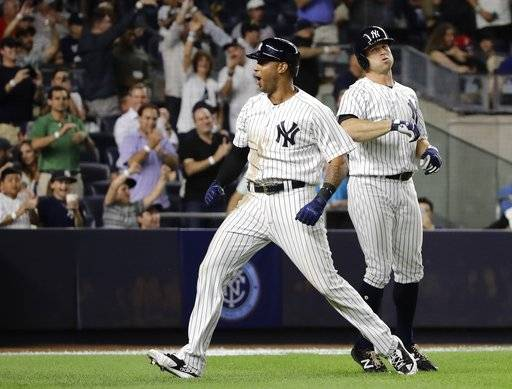 New York Yankees' Aaron Hicks (31) celebrates next to teammate Brett Gardner after hitting a two-run home run during the eighth inning of the team's baseball game against the Boston Red Sox on Friday, Aug. 11, 2017, in New York. (AP Photo/Frank Franklin II)