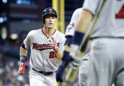 Minnesota Twins' Max Kepler is greeted at home plate after his two-run home run during the fifth inning of the team's baseball game against the Detroit Tigers, Friday, Aug. 11, 2017, in Detroit. (AP Photo/Carlos Osorio)