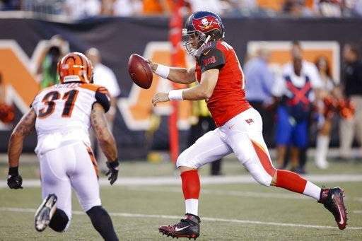 Tampa Bay Buccaneers quarterback Ryan Fitzpatrick, right, runs for a touchdown during the first half of the team's preseason NFL football game against the Cincinnati Bengals, Friday, Aug. 11, 2017, in Cincinnati. (AP Photo/Gary Landers)